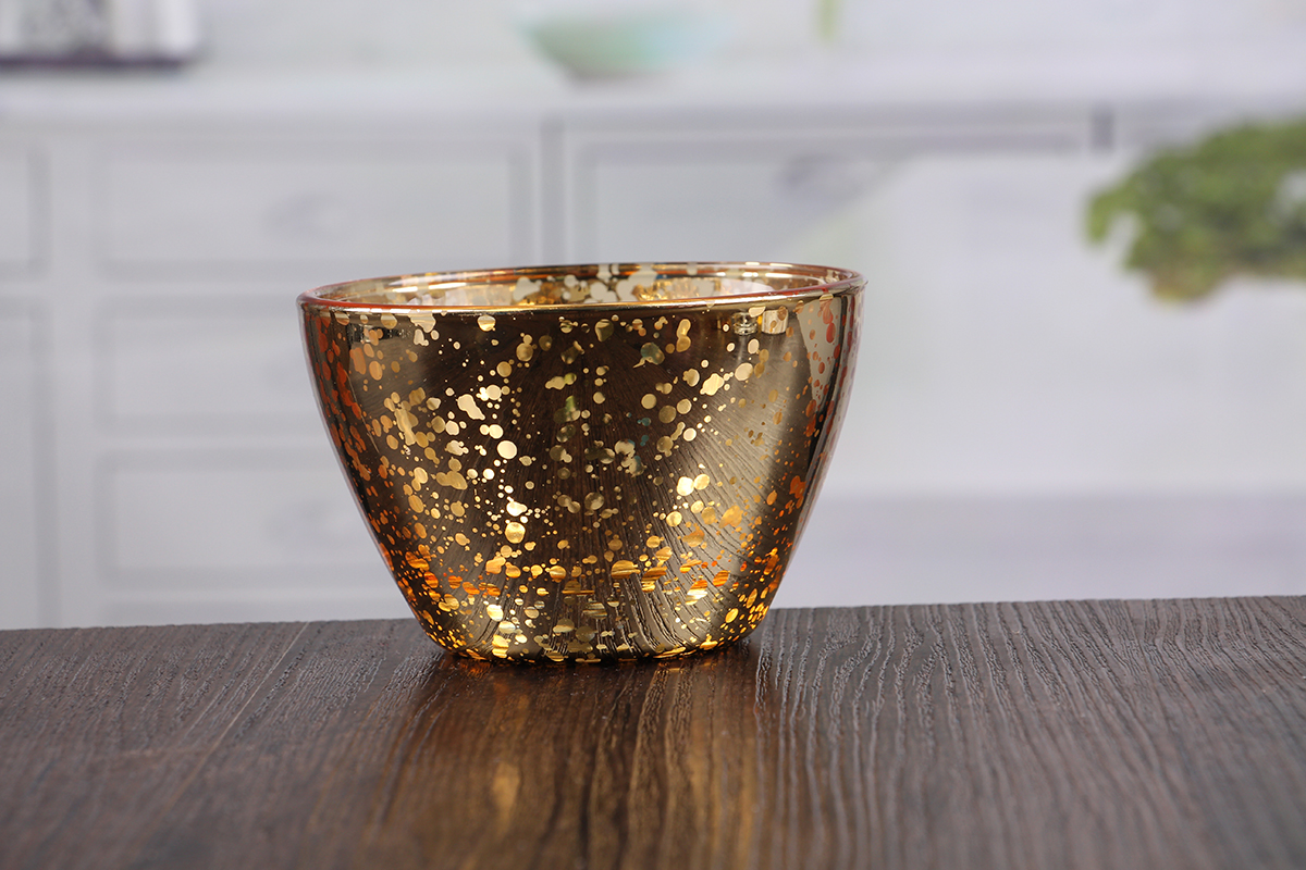 Glass bowl shaped candle holder