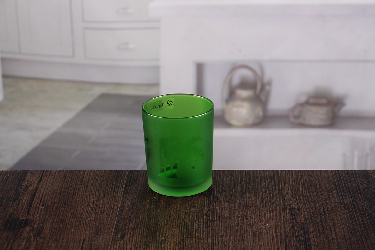 Small green candle holders